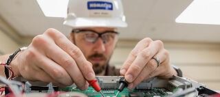 Komatsu engineer working on SR technology