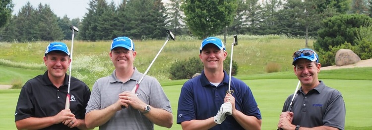 Komatsu suppilers golf for Habitat for Humanity