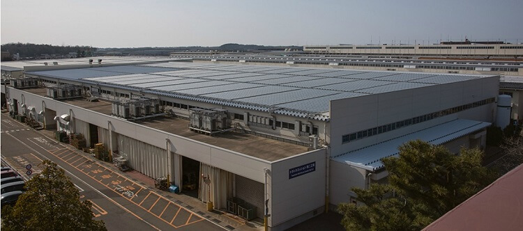 Komatsu's Awazu manufacturing plant in Japan uses renewable energy power for a sustainable future.