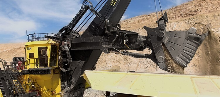 P&H 2650CX hybrid shovel using hydraulic power to open bucket