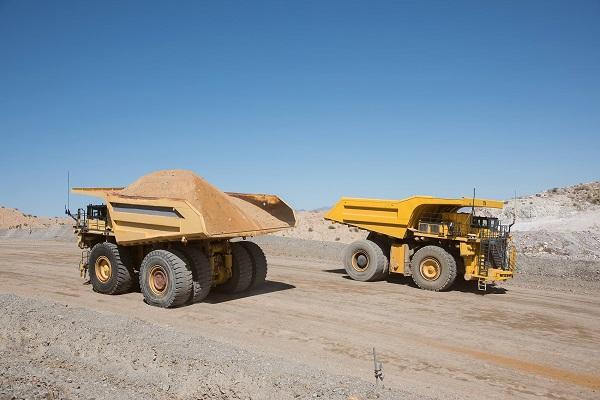 Two Komatsu Mining Haul Trucks With Material
