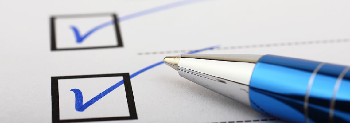 Blue pen marking checkboxes