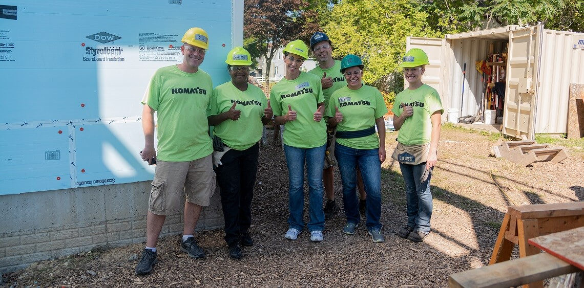 Komatsu employees volunteer their time to build safe and affordable housing through Habitat for Humanity